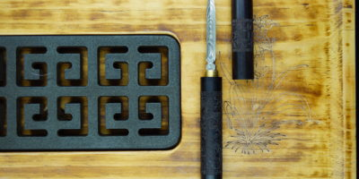 Dragon Pole exklusives Pu-Erh-Tee Messer mit Damaskus Muster Stahl